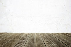 Wall and wood floor background Stock Images