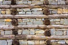 Wall of wood and rock Stock Photos