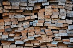 Wall of wood. Texture background of pre-cut sections of wood Royalty Free Stock Images
