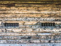 Wall of a wooden barn with windows stock photo