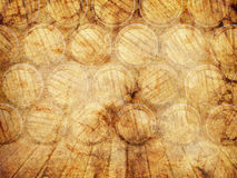 Wall of wooden barrels. On a grunge background Royalty Free Stock Images