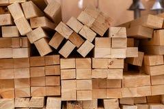 Wall of wooden beams, texture close-up. stock photos