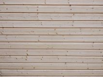 Wall of wooden beams, texture close-up royalty free stock photos