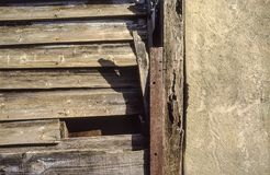 Wall of wooden boards and cement royalty free stock photo