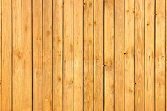 Wall of wooden boards. A simple background of wooden planks bound together Royalty Free Stock Photos