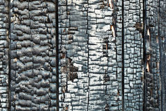 Wall of wooden building damaged by fire Stock Images