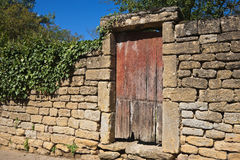 Wall and wooden door Royalty Free Stock Photos