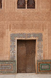 The wall and wooden door with details of islamic calligraphy Royalty Free Stock Images