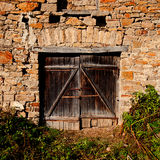 Wall and wooden door Royalty Free Stock Photo