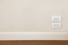 Wall with wooden floor and power outlet Stock Photo
