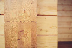 Wall of wooden houses from glued beams Royalty Free Stock Photos