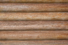 Wall of wooden logs. Background wall of pine logs Stock Photos