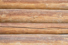 Wall of wooden logs. Background wall of pine logs stock photo