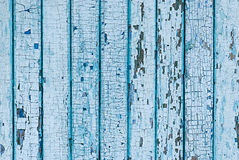 Wall from wooden planks with blue paint. Cracked paint on a wood Stock Photo