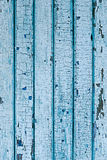 Wall from wooden planks with blue paint. Cracked paint on a wood Royalty Free Stock Photo