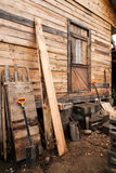 Wall of the wooden unfinished house. And tools Stock Images