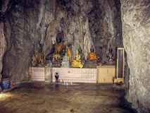 Wall of worship with a statue and accessories in Thailand stock image
