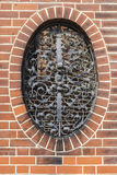 Wall with wrought iron window in Berlin, Germany. Wall with wrought iron window in St Mary church Marienkirche located near Alexanderplatz in Berlin, Germany royalty free stock image