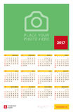 Wall Yearly Calendar Poster for 2017 Year. Vector Design Print Template with Place for Photo. Week Starts Sunday. 12 Months on Page. Stationery Design Vector Illustration