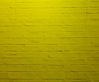Wall of yellow bricks. Yellow boils are stacked exactly royalty free stock photos