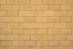Wall of yellow brickwork background Stock Image
