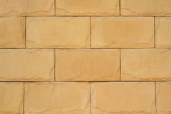 Wall of yellow brickwork close-up background Stock Photography