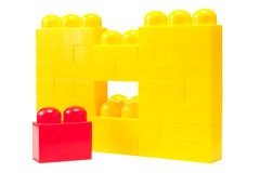 Wall of yellow building blocks and missing red Royalty Free Stock Image