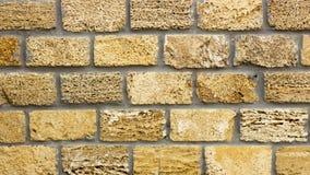 Wall of yellow coquina blocks closeup. Background Stock Photo