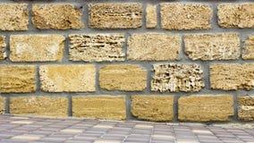 Wall of yellow coquina blocks closeup. Background Royalty Free Stock Photos