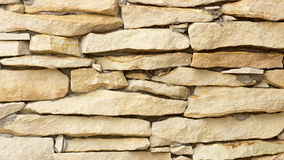 Wall of yellow coquina blocks closeup. Background Royalty Free Stock Images