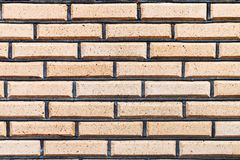 Wall from yellow decoration bricks Royalty Free Stock Image