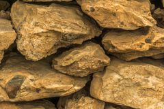 A wall of yellow lava rock as. A background Stock Photography