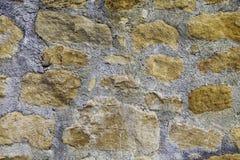 Wall in yellow limestone Stock Image