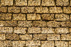Wall of yellow stone Stock Images