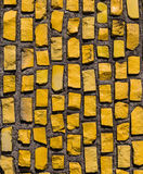 Wall with yellow stone rock. Stock Photography