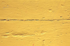 Wall with yellow weathered pattern peeling paint b Stock Photos
