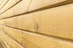 Wall of yellow wooden panels, perspective view, abstract background royalty free stock photography