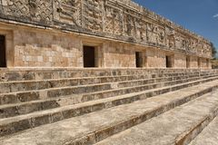 Wallcarvings at the prehispanic town of Uxmal. Rich facade carvings at the prehispanic town of Uxmal , a Unesco World Heritage site Royalty Free Stock Image