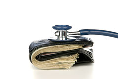 Walled with cash being examined with stethoscope Royalty Free Stock Photo