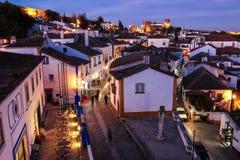 Walled citadel at night. Obidos. Portugal. The main street ( Rua direita). Souvenir shops, pubs and restaurants at night. Obidos. Portugal Royalty Free Stock Photo
