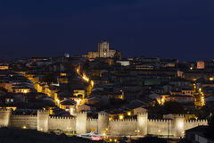 Walled city at night. Ávila Stock Photo
