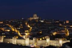 Walled city at night. Ávila Stock Photo