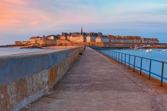 Medieval fortress Saint-Malo, Brittany, France. Walled city Saint-Malo with St Vincent Cathedral at sunset. Saint-Maol is famous port city of Privateers is known royalty free stock image