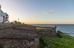 The Walled City of San Juan. Portion of the walls surrounding the coastal city of Old San Juan in Puerto Rico. To the left are the tourist filled streets of the stock photos