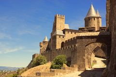 The walled fortress city of Carcassonne, southern France. The cobbled entrance to the walled city fortress of Carcassonne in the south of France royalty free stock photography