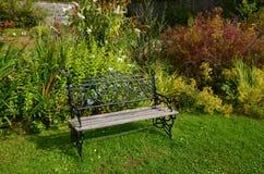 Walled garden, Applecross. A wrought iron garden becnh at the walled garden, Applecross, Scotland Royalty Free Stock Photos