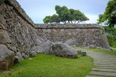 Walled path with path and trees stock image
