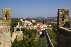 """Walled town, Ã""""bidos. A general view of the walled town of Ã""""bidos, Portugal. Horizontal version royalty free stock images"""