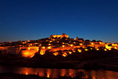 Walled town illuminated at night Royalty Free Stock Photos