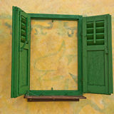 Walled window with green shutters Stock Image